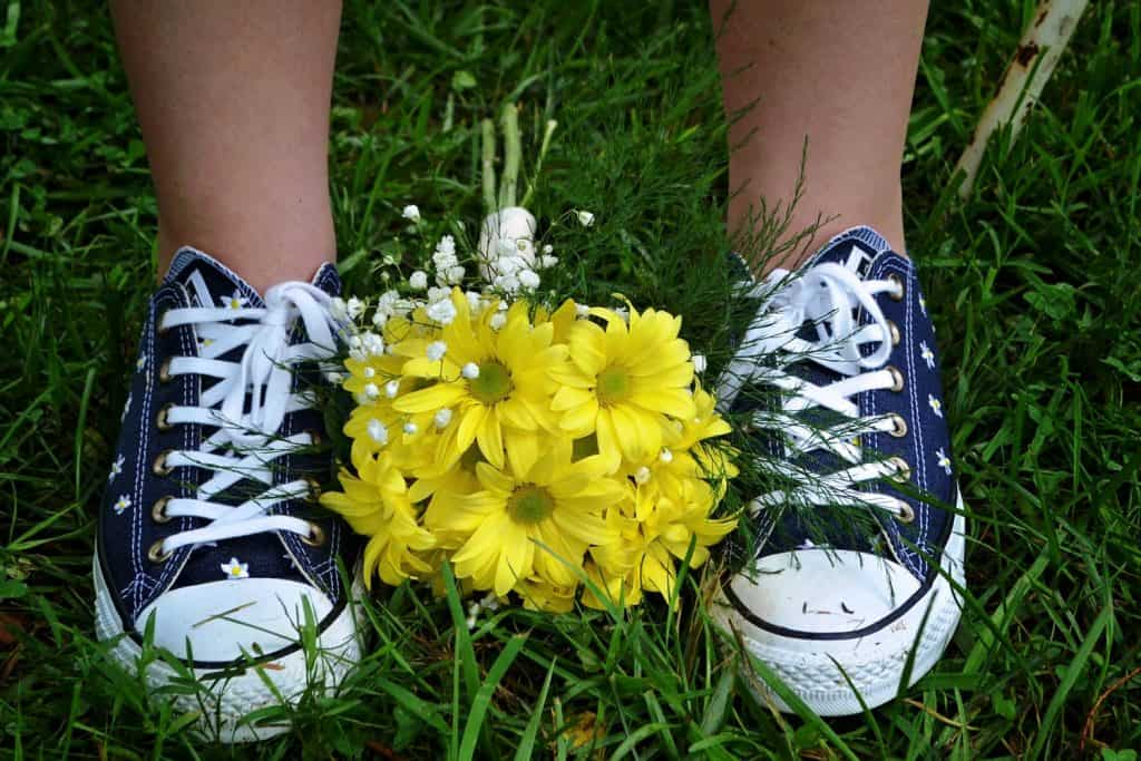 Navy Blue Converse Tennis Shoe with Yellow Daisy Bouquet