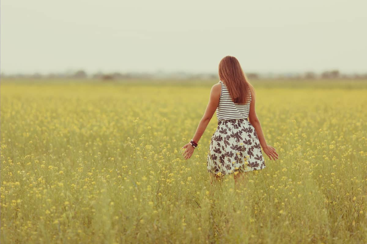 Portrait of a beautiful girl in a field with yellow flowers, summer, sunset, plaid skirt, How To Wear A Short Skirt With Boots