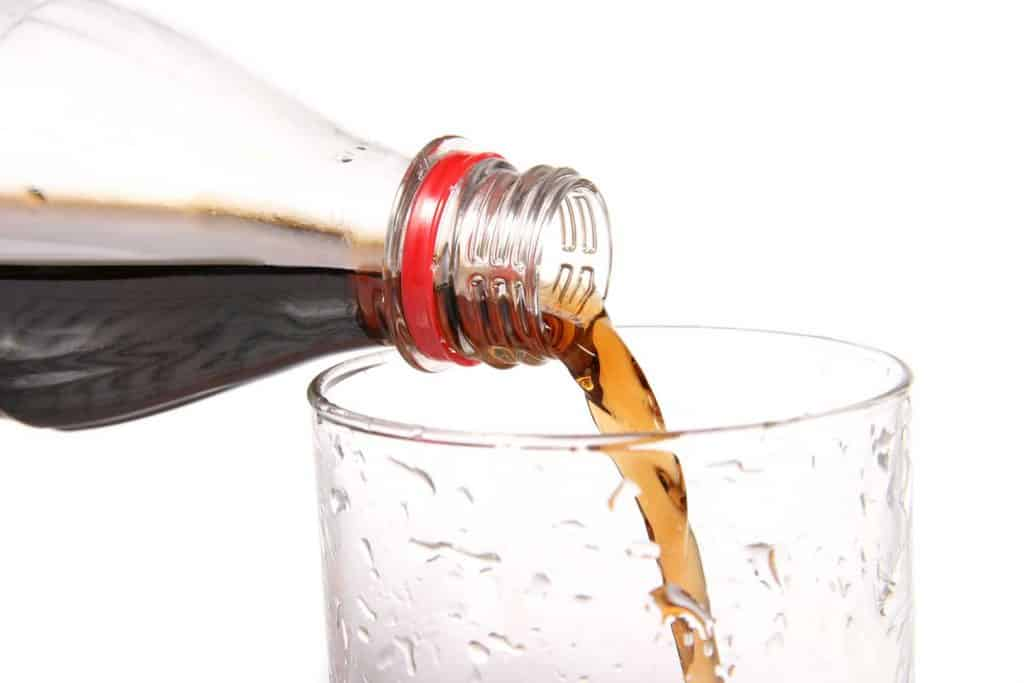 Pouring cola into a glass