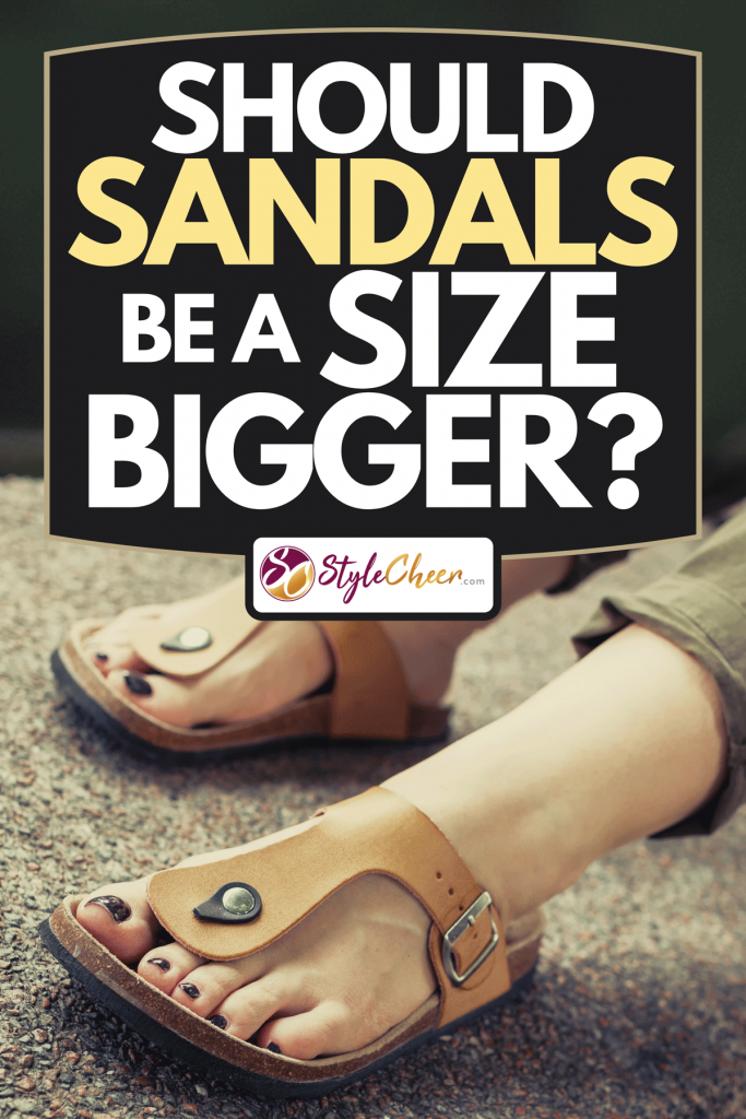 A woman's feet in yellow stylish summer sandals with dark nail polish, Should Sandals Be A Size Bigger?