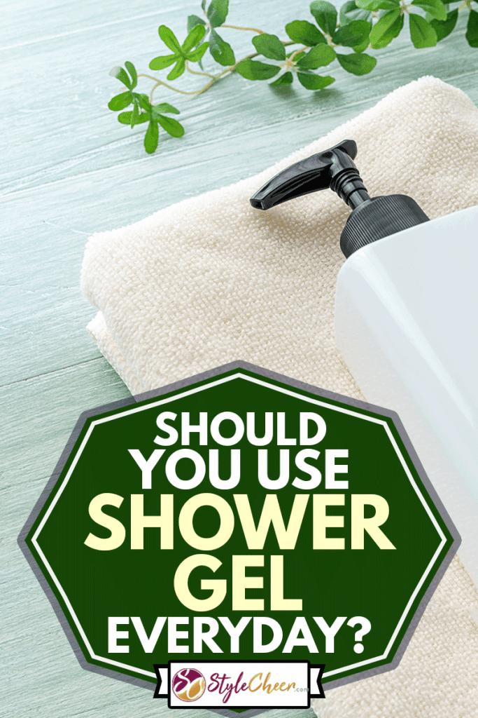 Shower gel bottle and towel on wooden background, Should You Use Shower Gel Everyday?