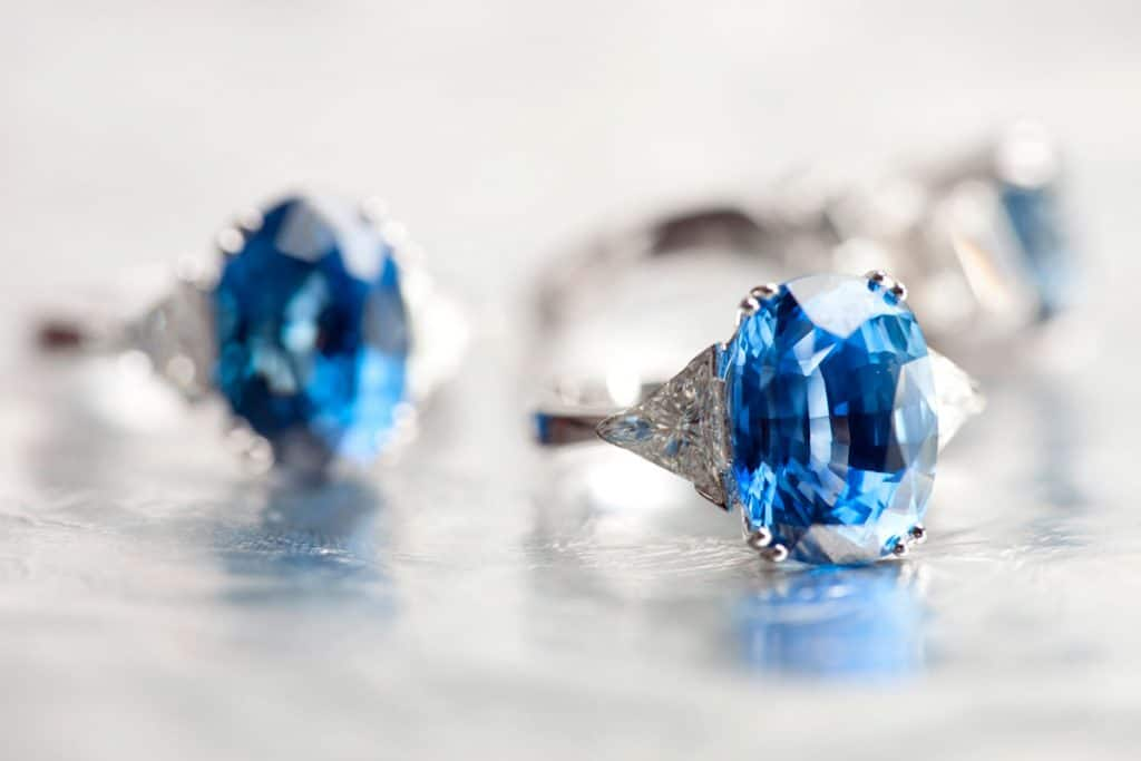 Three expensive perfectly cut blue diamond rings on a gray background, 6 Best Gemstones for Engagement Rings