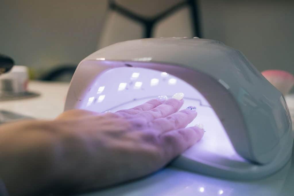 UV lamp gel polish process inside an expensive salon