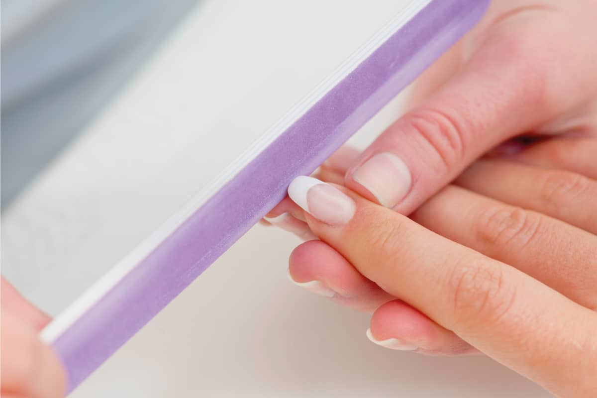 Using nail file on shellac nails in salon, How Much Do Shellac Nails Cost?