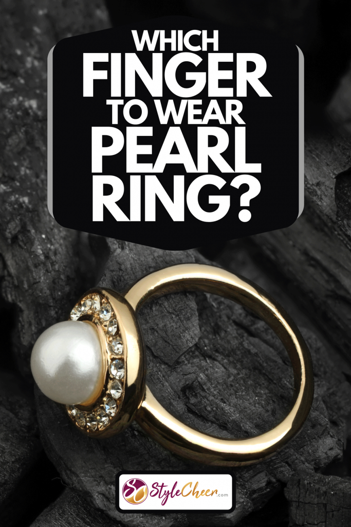A jewelry ring with diamond and pearl on black coal background, Which Finger To Wear Pearl Ring?