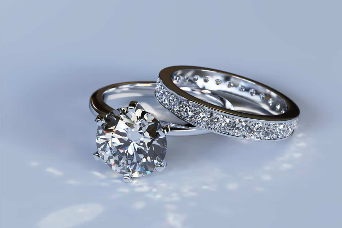 White gold solitaire diamond engagement ring and eternity wedding band with round brilliant cut diamonds