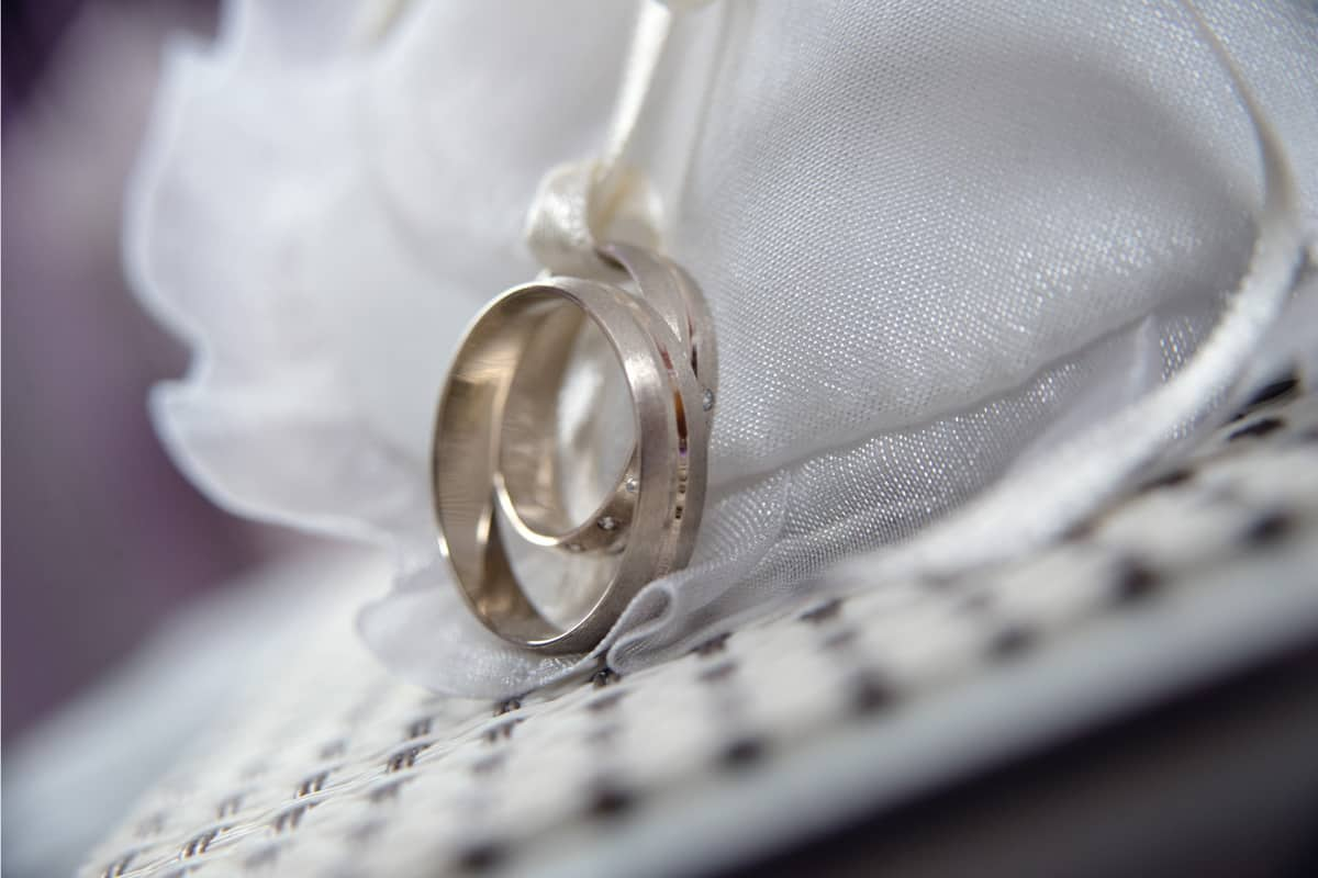 White gold wedding rings on fabric