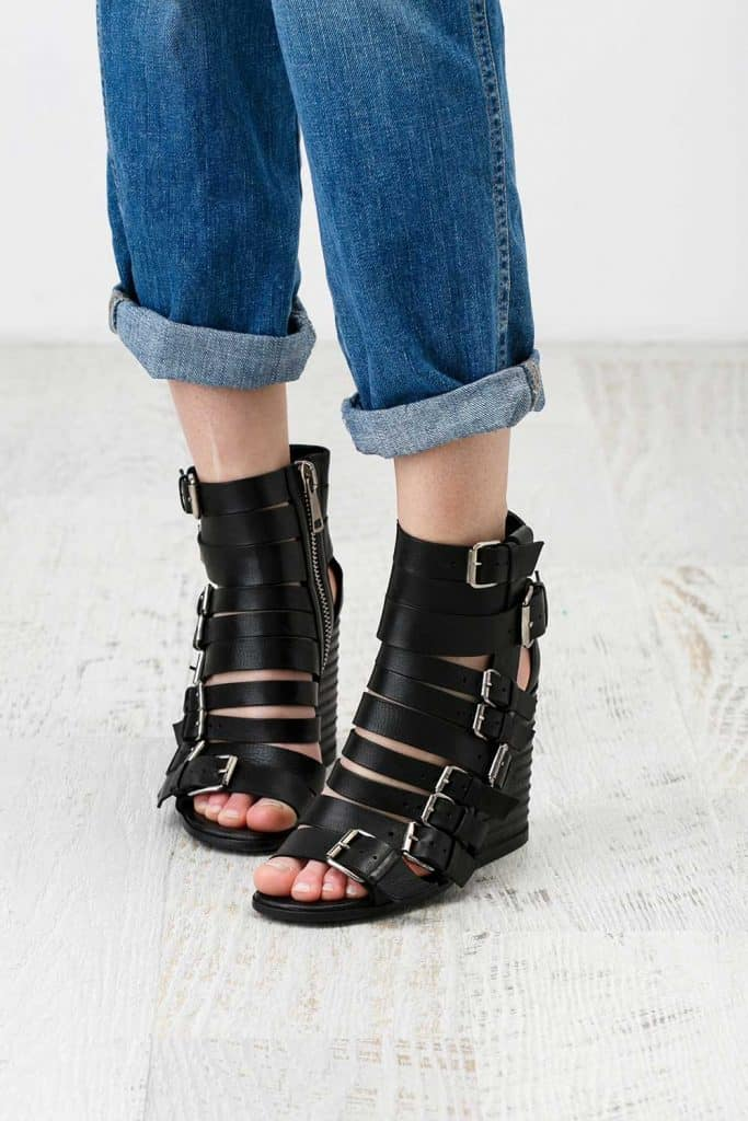 Woman feet in the chunky sandals