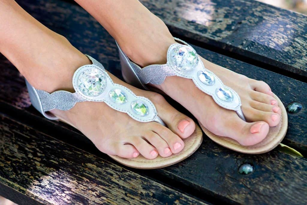Close up of woman's feet wearing fashionable sandals