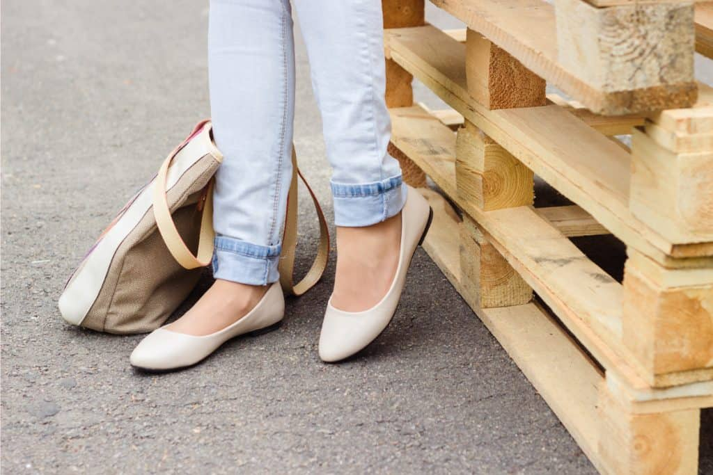 Woman's legs in jeans and flat shoes, What To Wear With Flats?