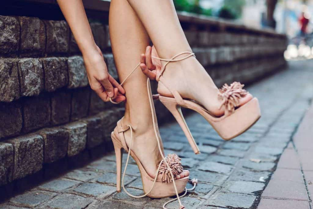 Young beautiful woman is wearing high heel sandals, What Color Sandals Go With Everything?