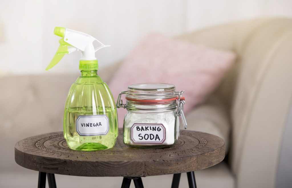 Using baking soda Sodium bicarbonate and white vinegar for home cleaning.