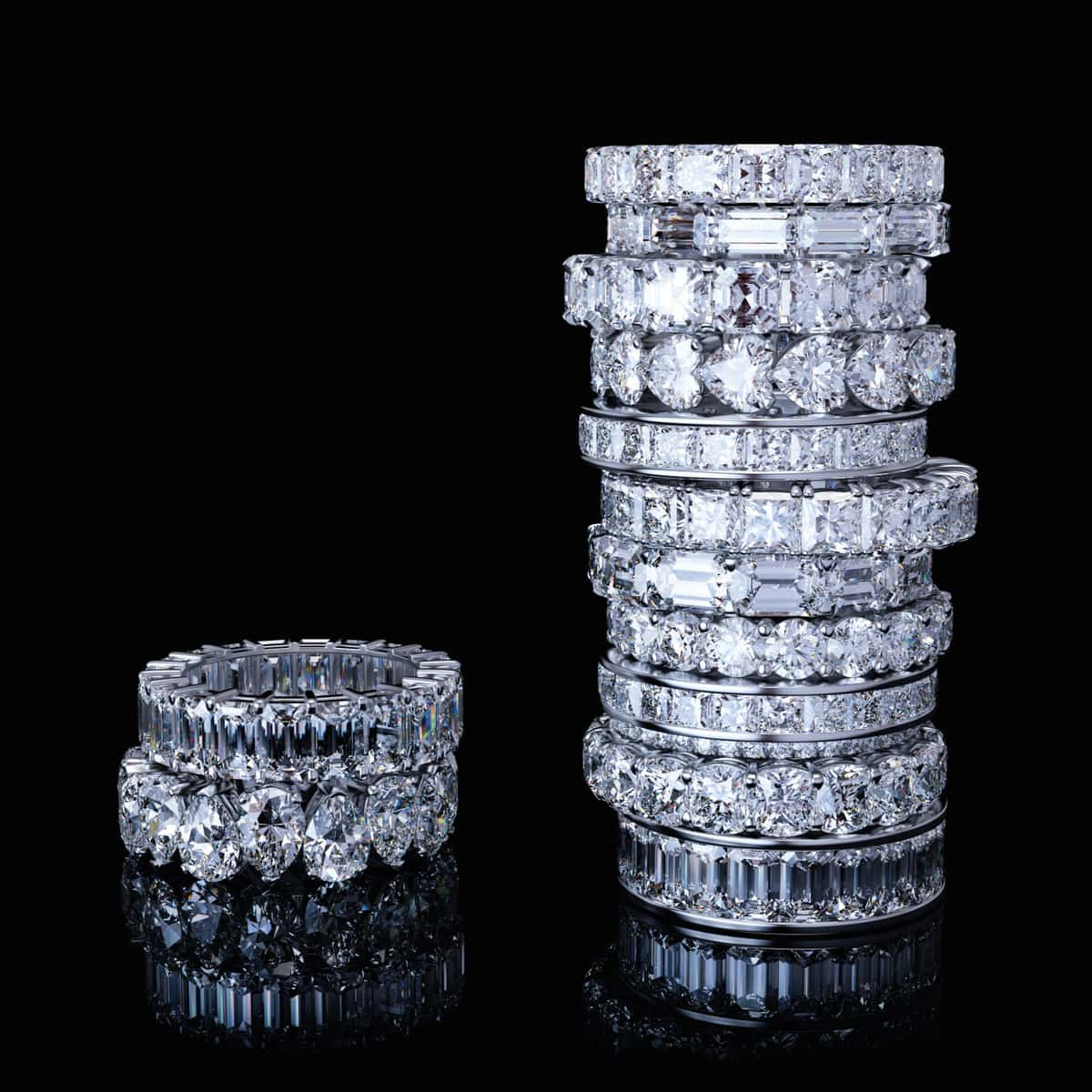 Stack of white gold eternity (infinity) diamond anniversary rings with variously cut diamonds