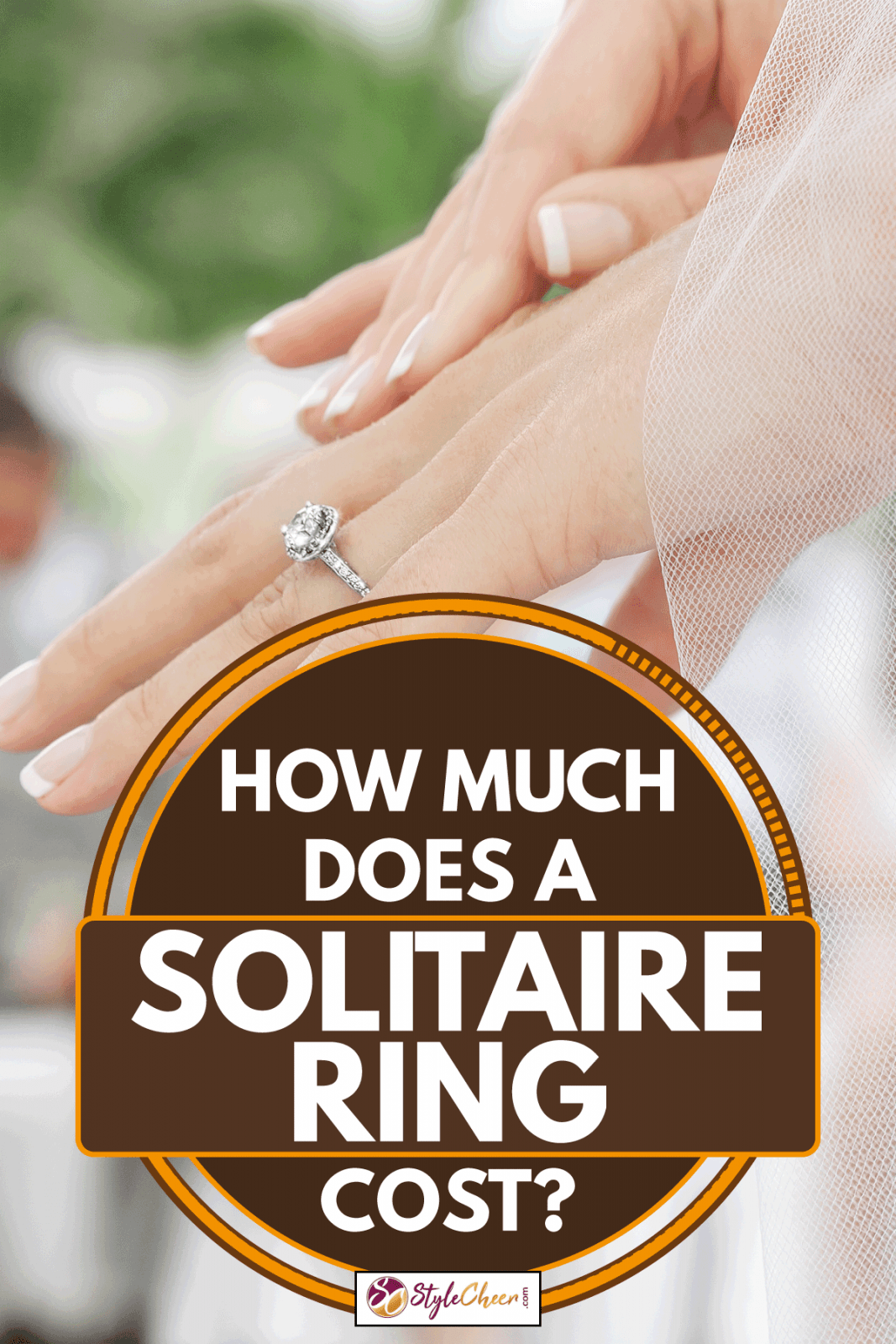 Woman's hand with diamond solitaire ring, How Much Does A Solitaire Ring Cost?