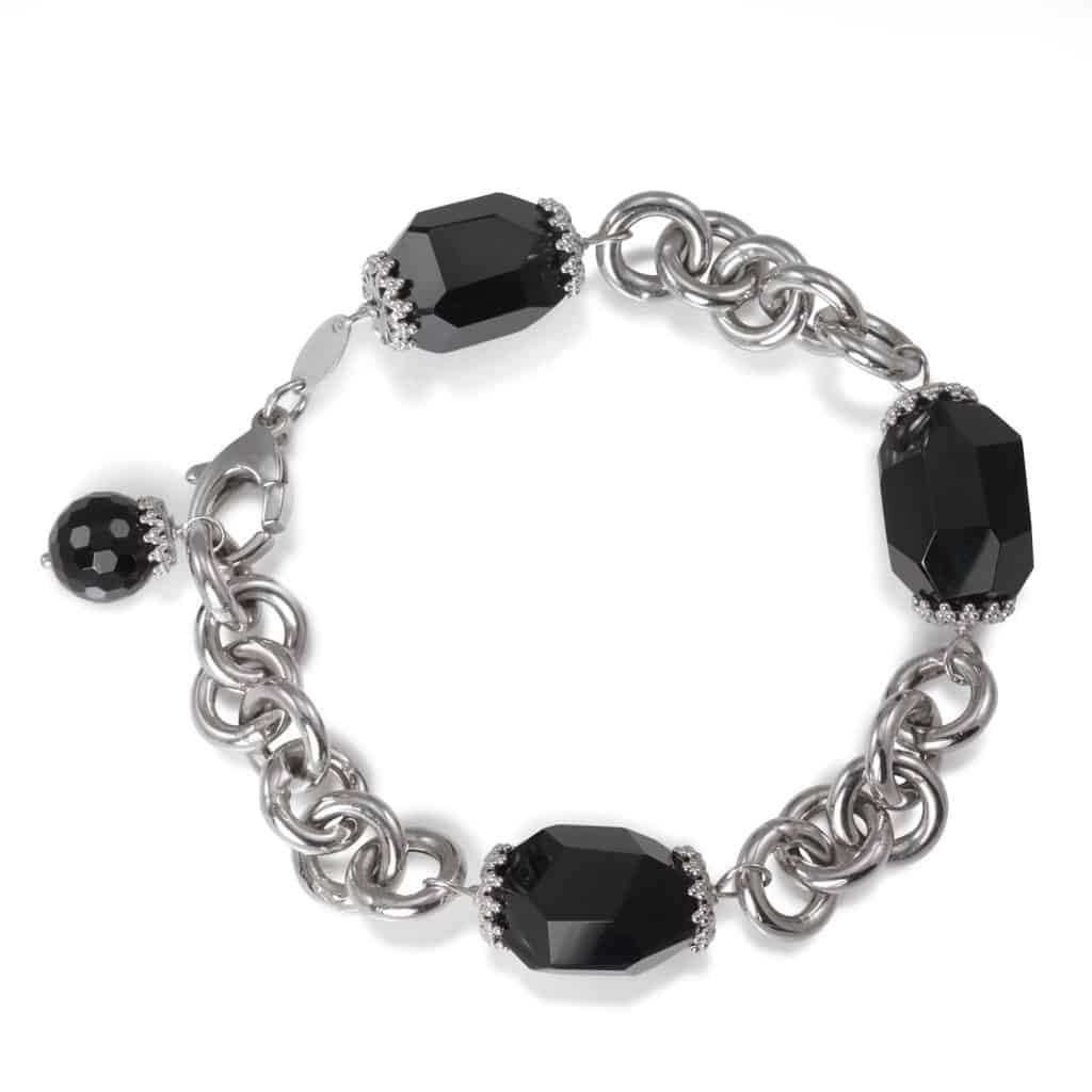 A black and a silver onyx bracelet on a white background