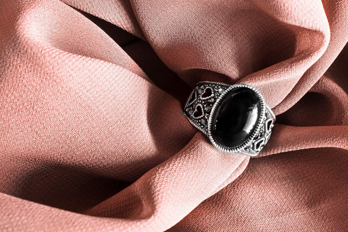 A gorgeous silver onyx ring on a pink cloth, Does Onyx Jewelry Scratch Easily?