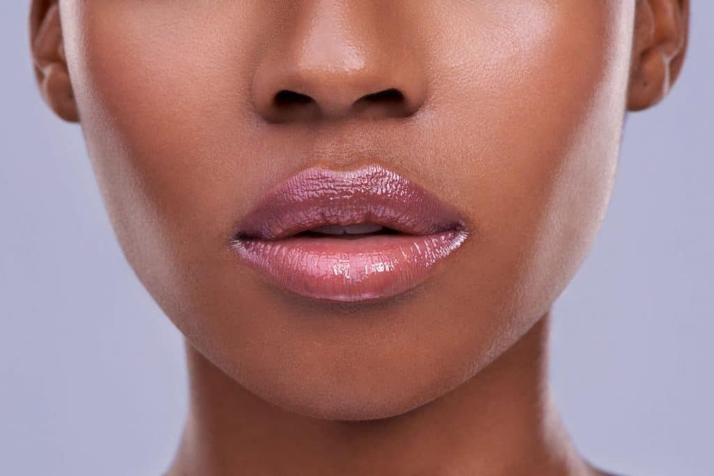 A woman showing her gorgeous dark pinkish lips