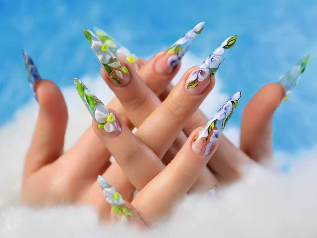 Acrylic flowers on woman's nails