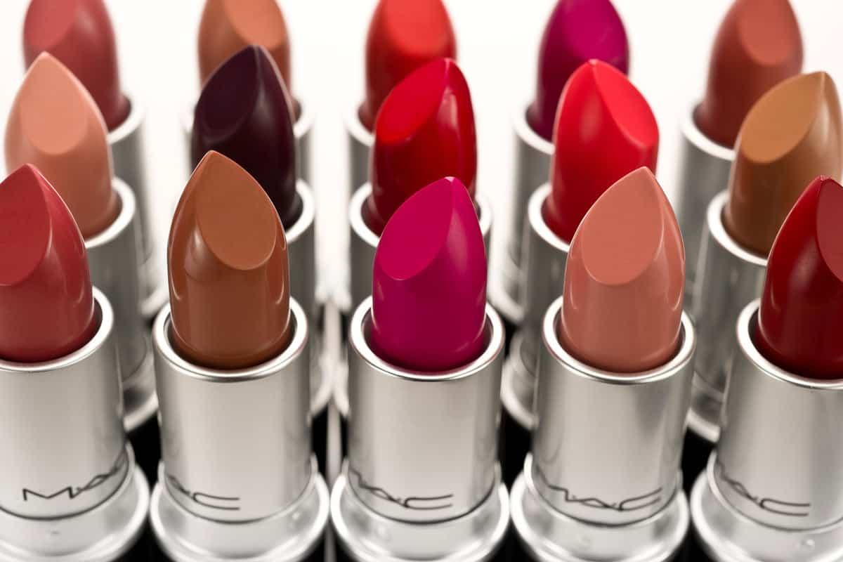 Different colors and shades of lipsticks on a white background