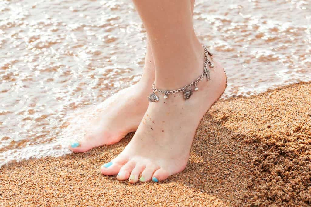 Feet of a young girl and anklet ankle, 20 Types Of Anklets You Should Know