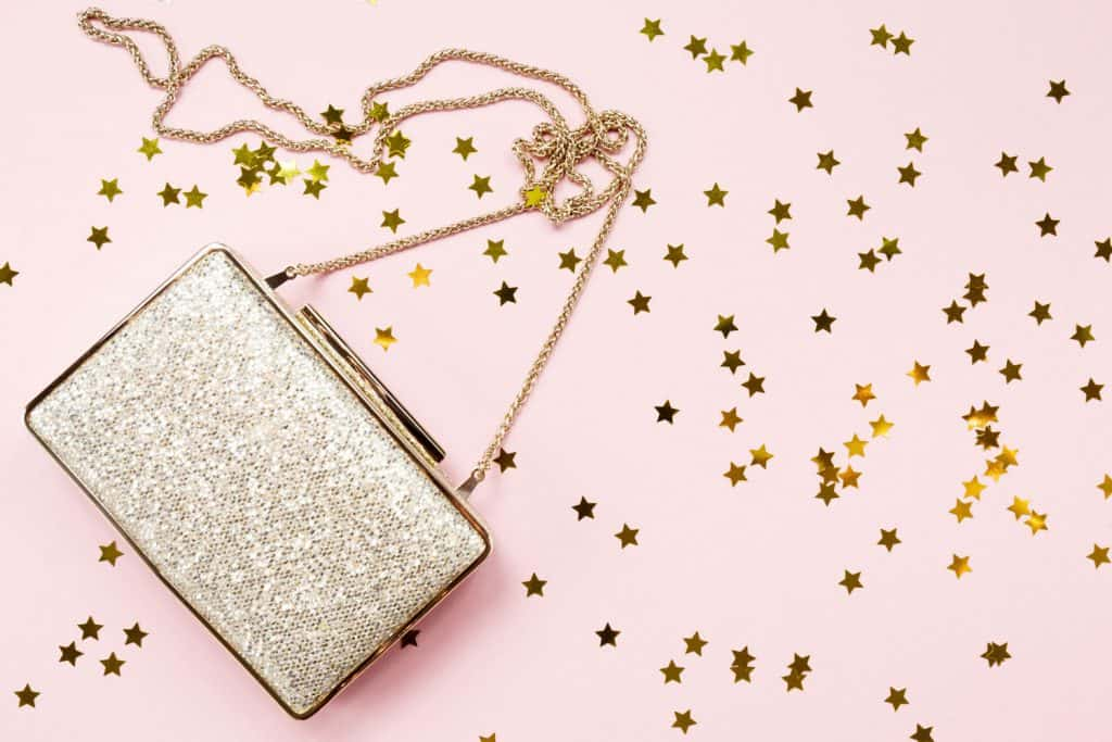 Festive evening golden clutch with star sprinkles on pink, 18 Types Of Purses And Handbags [The Ultimate Guide]