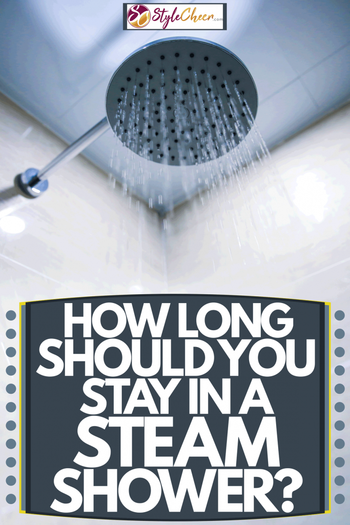 A steam shower head turned on inside a sauna room, How Long Should You Stay In A Steam Shower?