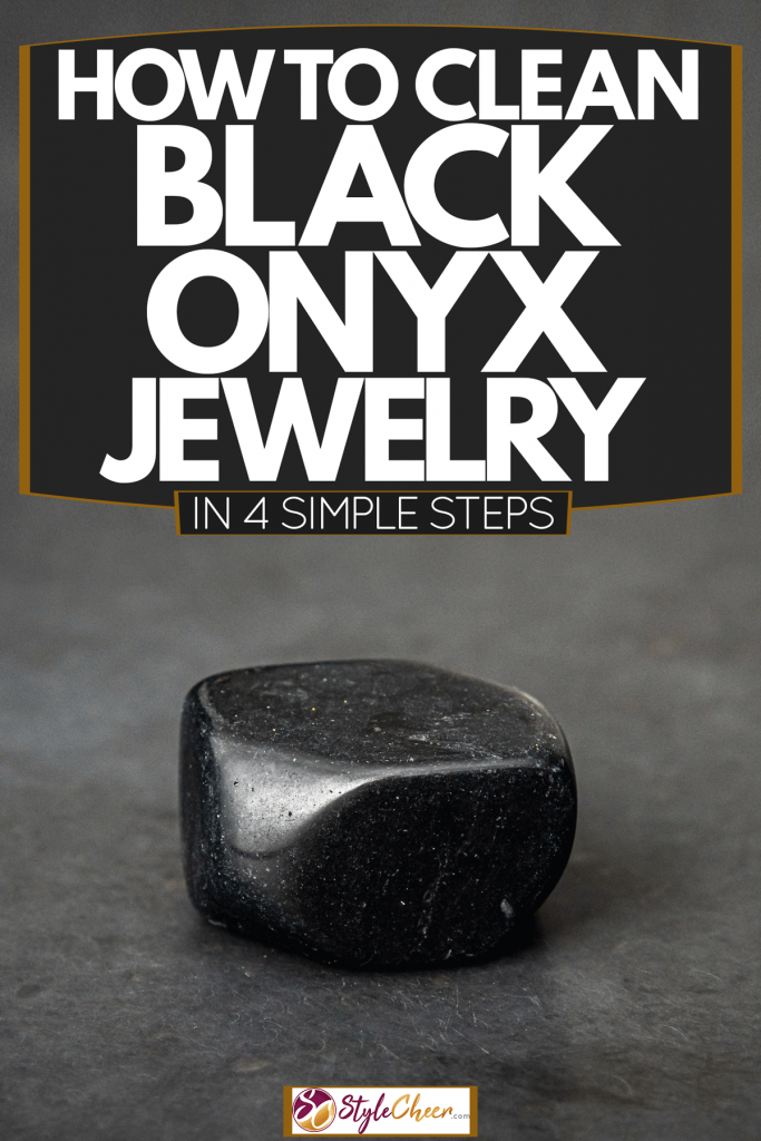A gorgeous shining black onyx stone with glowing light particles on its surface, How To Clean Black Onyx Jewelry In 4 Simple Steps
