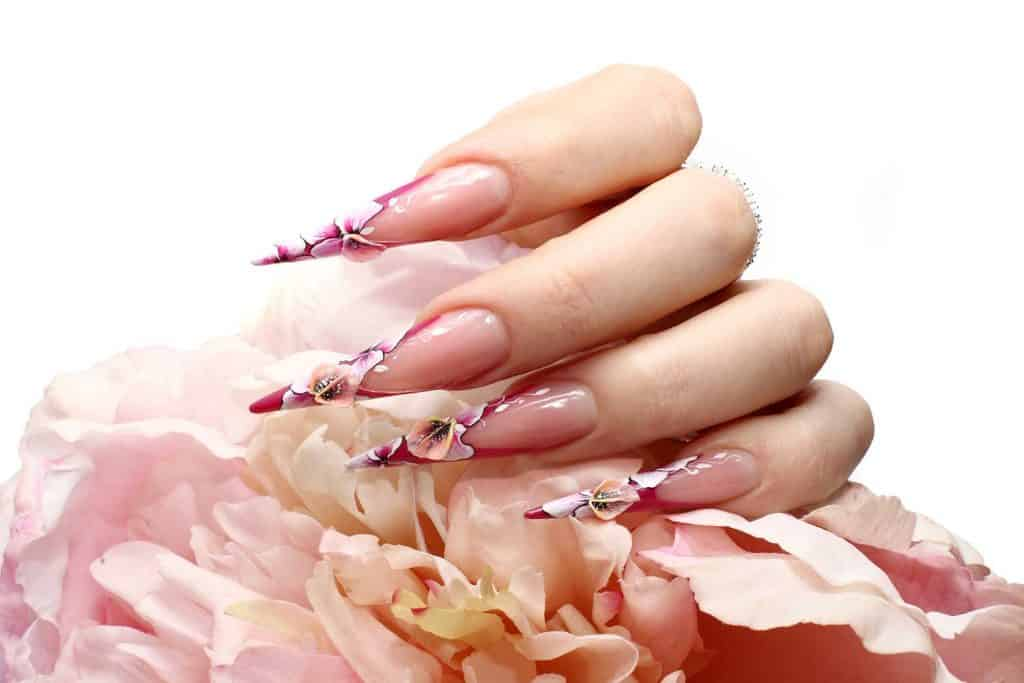 Manicured acrylic nails with floral designs
