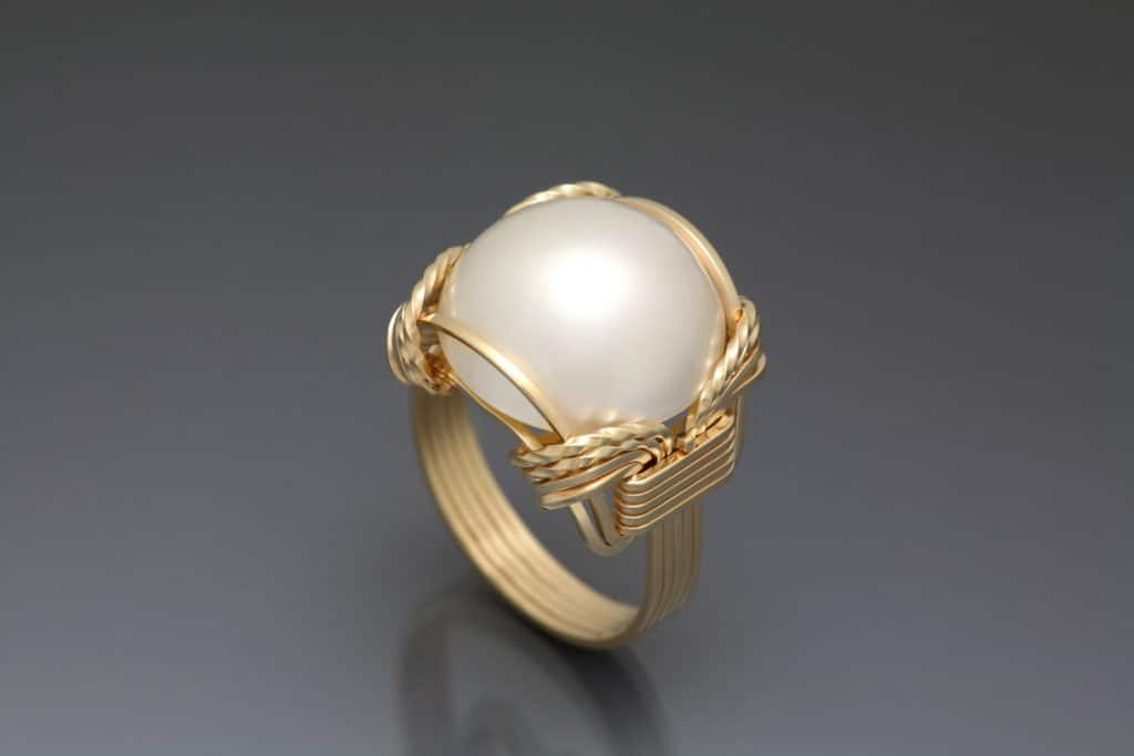 Mobe Pearl set in gold wire.