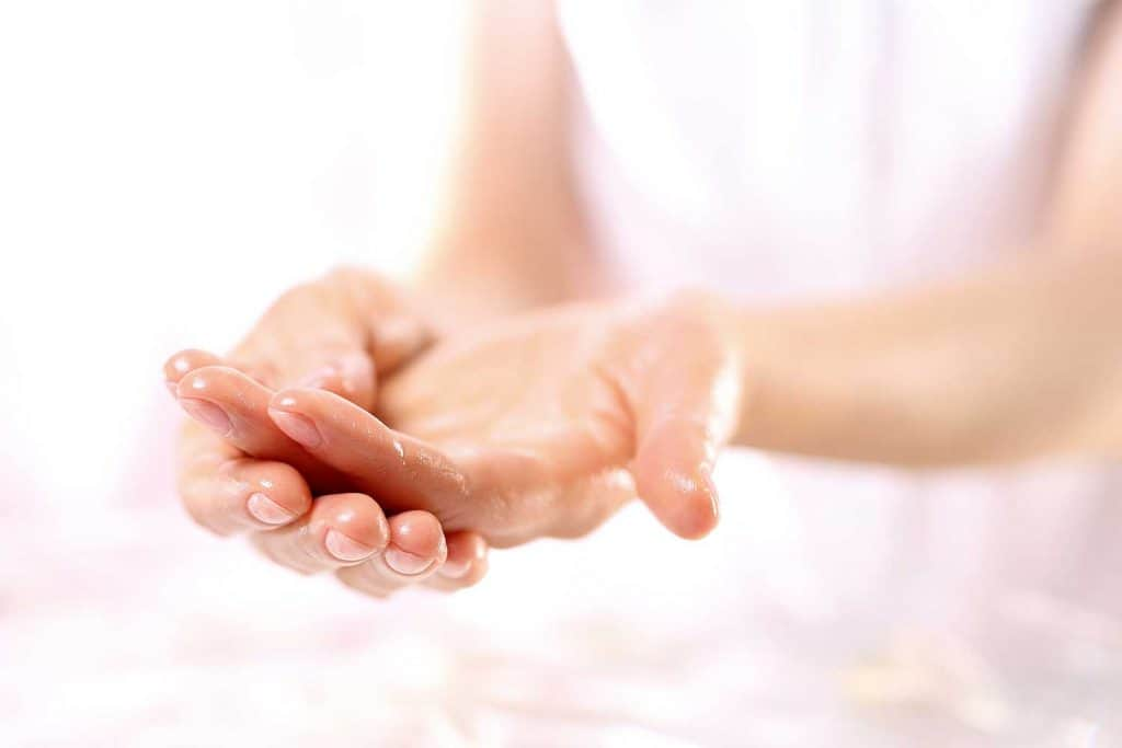 Paraffin hand treatment in beauty salon