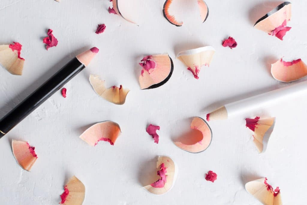 Pieces of sharpened lip liners on a table