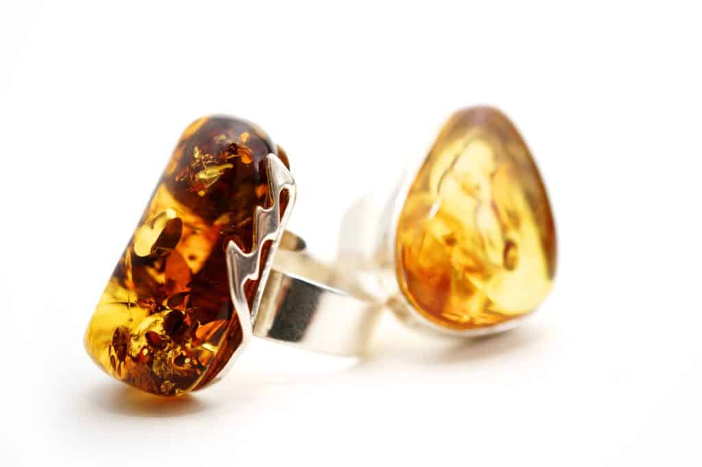Silver rings with large pieces of amber