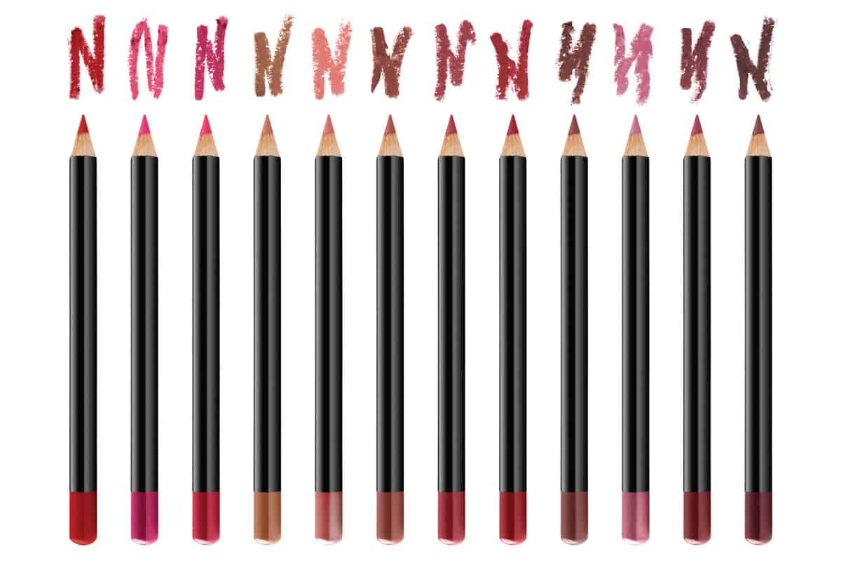 Twelve lips contour cosmetic pencils with color stroke samples, beauty products