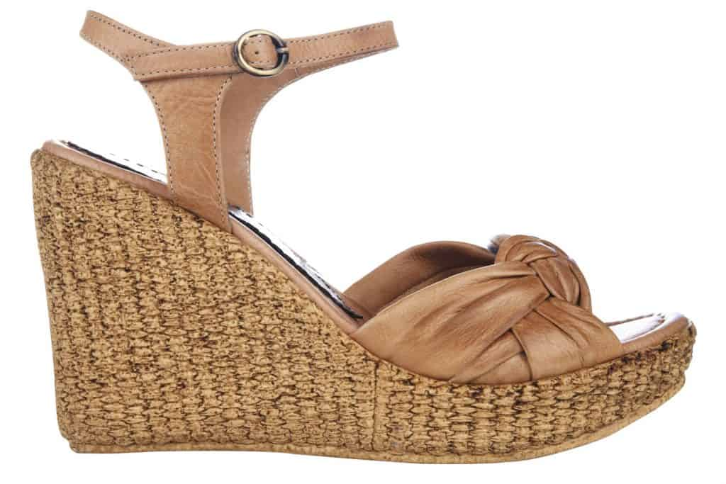 Women's high heeled brown rope wedge shoe on a white background