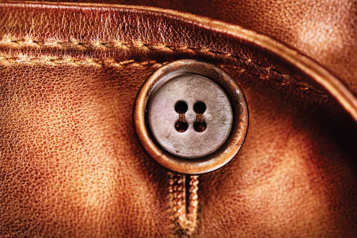 close up of faux leather jacket with button. How To Wash A Faux Leather Jacket [4 Easy Steps]