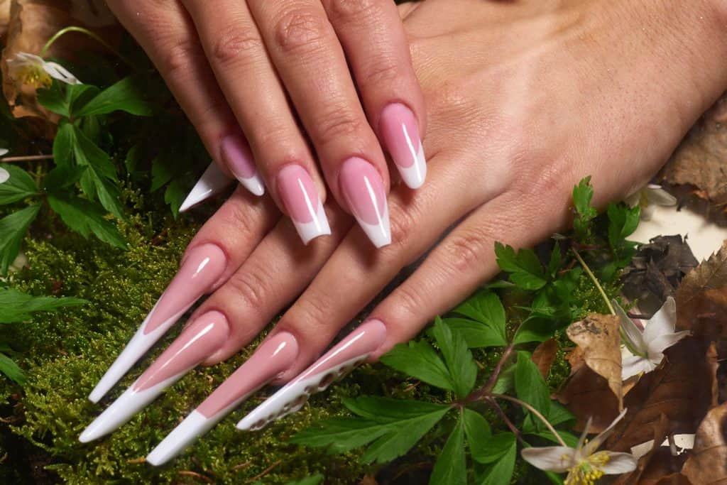 horizontal shot of unrecognizable woman hands with glamour long artificial acrylic nails, Why Do My Acrylic Nails Keep Lifting?