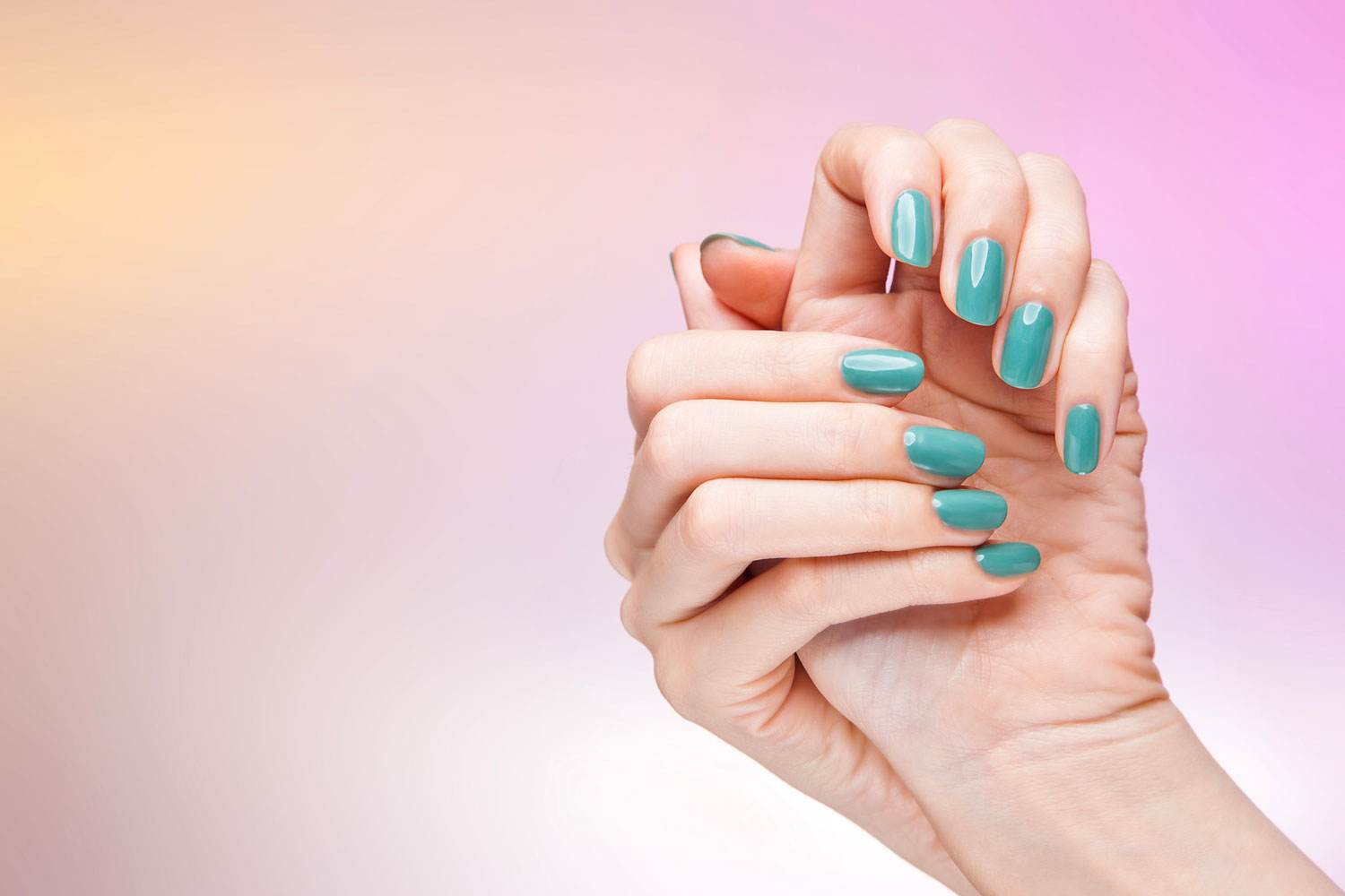 A woman showing her sky blue colored acrylic nail designs on a gradient background, How Long Do Acrylic Nails Last?