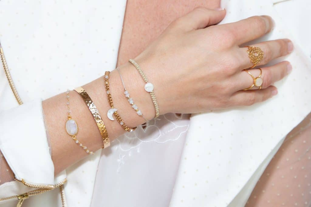 A woman wearing different kinds of bangle bracelets on right hand, How To Open A Bangle Bracelet