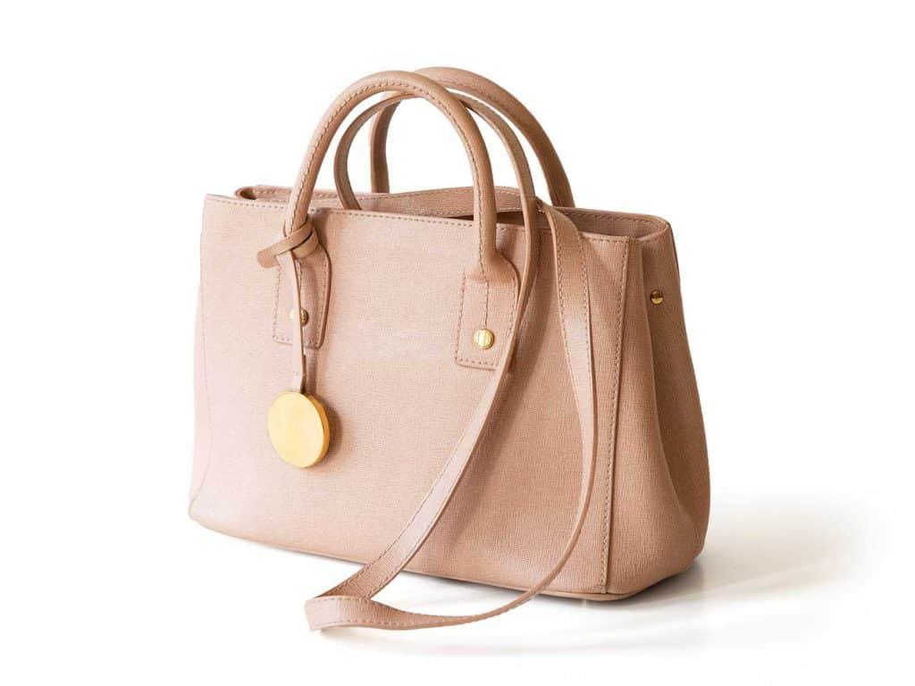 Beige leather women handbag isolated on white background