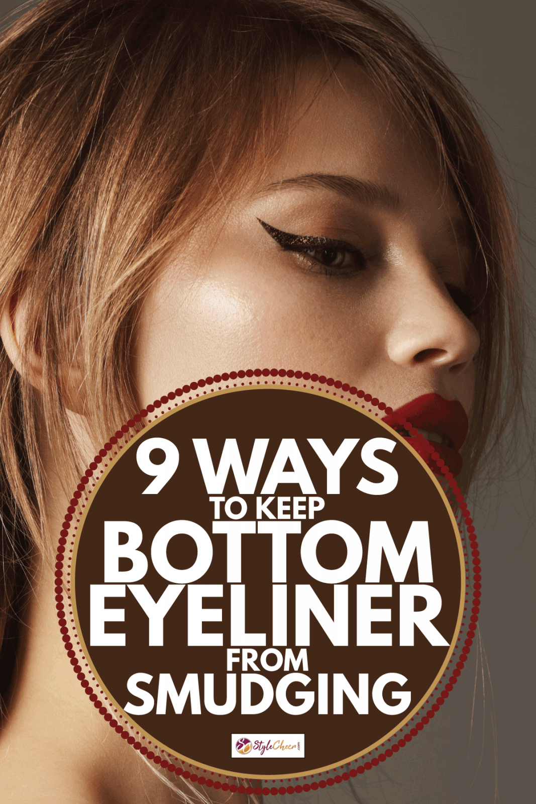 Close-up portrait of beautiful woman with red lipstick and cat eye make-up. 9 Ways To Keep Bottom Eyeliner From Smudging