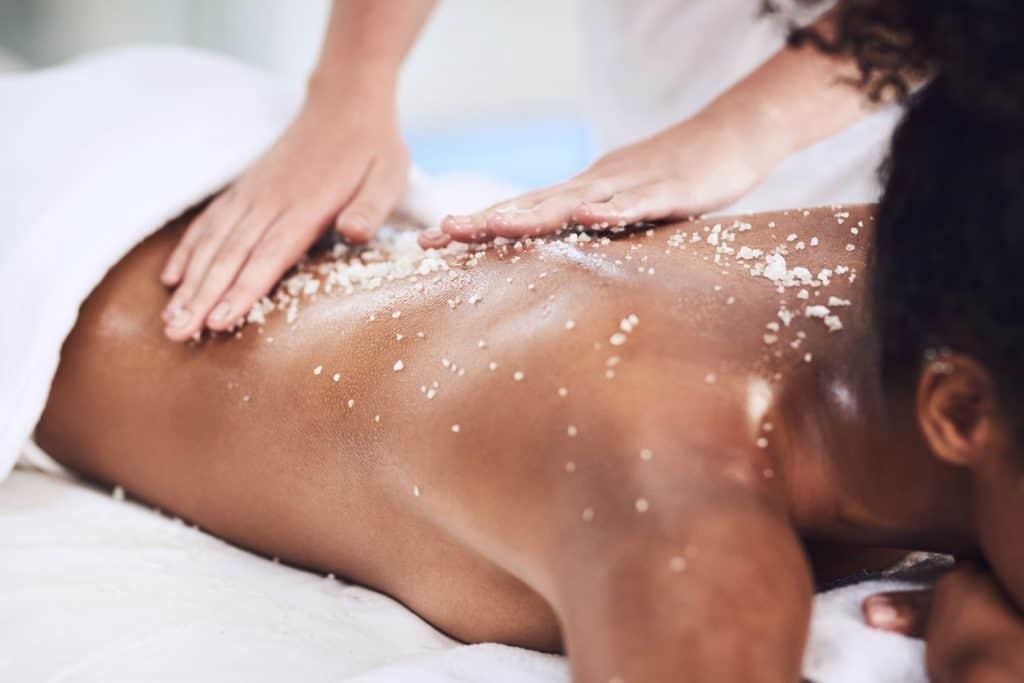 Closeup shot of a woman getting an exfoliating massage at a spa