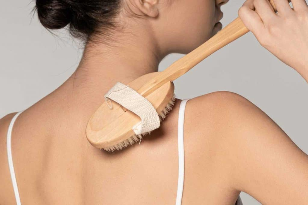Cropped view of young woman using dry massage brush, 5 Great Body Scrub Alternatives To Try Out