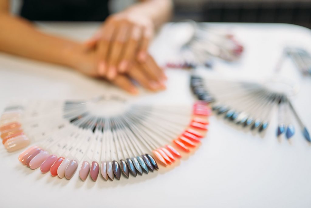 Different colored nail design templates on a table