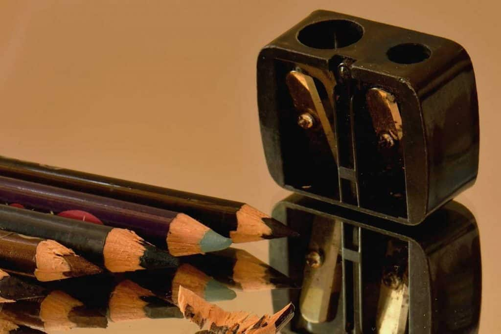 Eye pencils, sharpener and their reflection in the mirror, How To Sharpen Charlotte Tilbury Lip Liner
