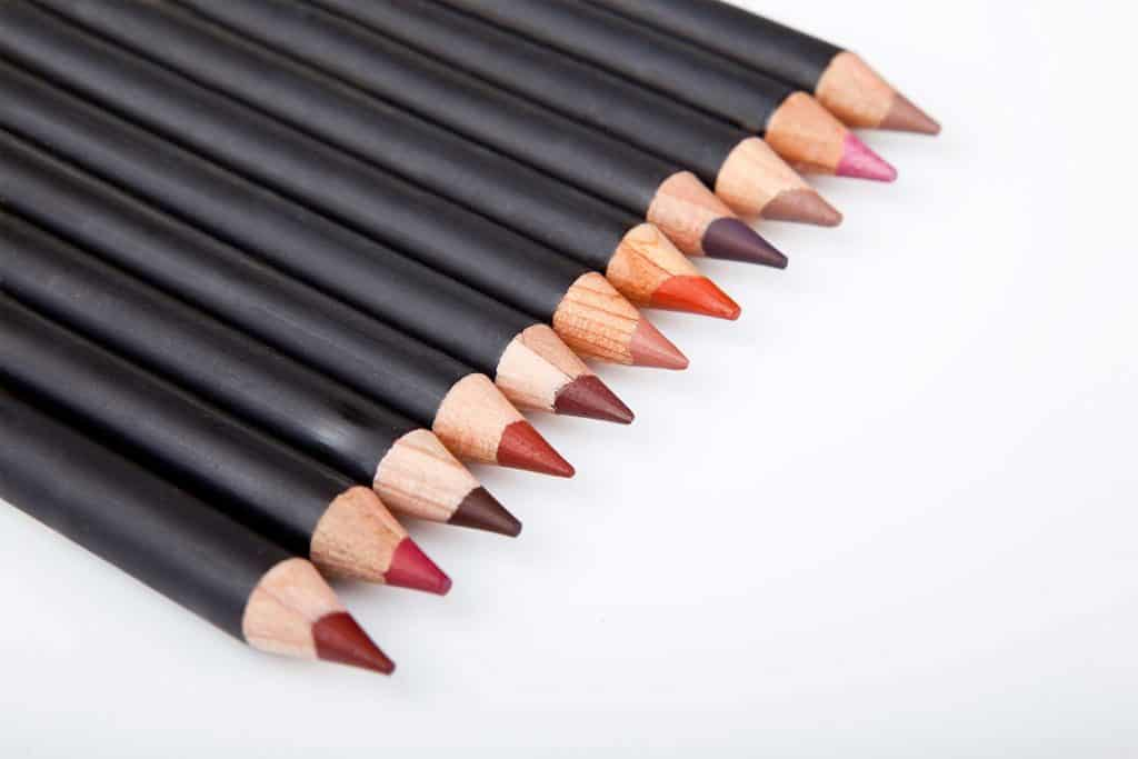 Makeup pencils with different shades in white background