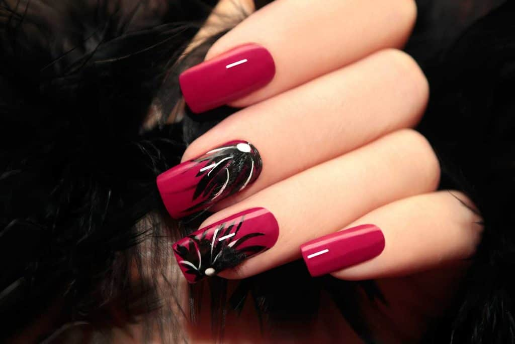 Nails painted with burgundy manicure