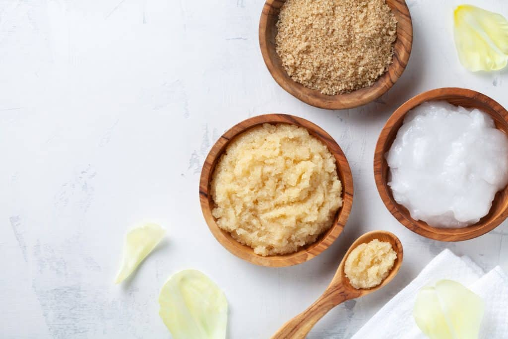 Sugar body scrub with ingredients on white stone table. Homemade cosmetic for spa and beauty with copy space, Does Body Scrub Exfoliate Skin?