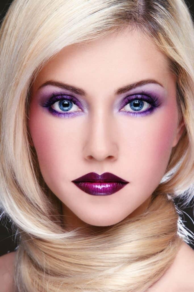 Violet makeup, blue eyes blonde hair