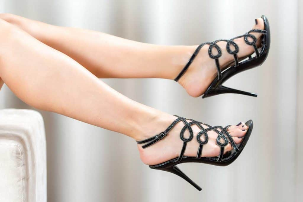 Woman´s legs in elegant high heel shoes in black patent leather with rhinestones, How To Stretch Strappy Heels [5 Easy Methods!]