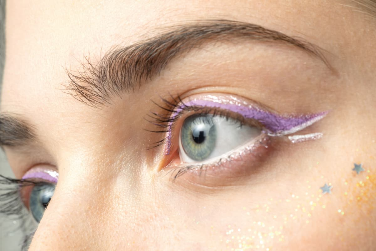 close up woman eyes with bright makeup